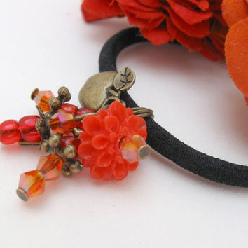 Ponytail holder with red beads, resin flower and vintage brass apple charm