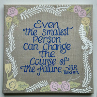 Hand painted 8x8 inch J.R.R. Tolkien quote on stretched linen • All hand lettered • no stencil • With flower border.