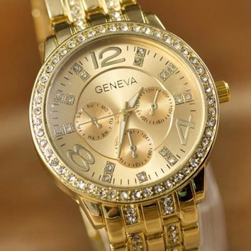 2015 New Style Fahion Gold Color Three Eyes Six Pin Crystal Dial Steel Band Geneva Quartz Relogios Watch Women Men = 1956334532