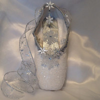 Nutcracker Snow themed decorated pointe shoe.