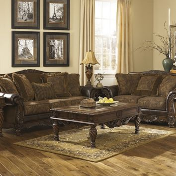 Ashley Furniture 63100-38-35 2 pc fresco collection two tone antique fabric and bonded leather upholstered sofa and love seat set with rounded arms and wood trim