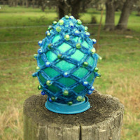 Metallic teal macrame egg with blue hemp macrame, blue & green beads over a hand painted egg  - includes egg stand and optional hanging line