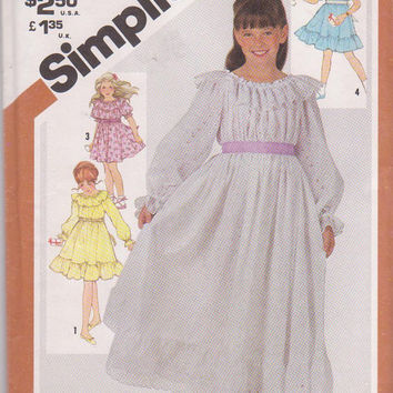 Vintage 1980s pattern for pullover peasant style dress in knee or floor length with optional ruffles girls size 7 Simplicity 5396 UNCUT