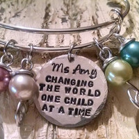 """Personalized """"Changing the world one child at a time"""" Bangle Bracelet"""