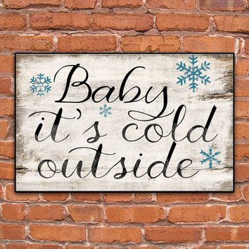 Baby it's cold outside wooden sign.  Approx. 12x19x3/4 inches.  Handmade.