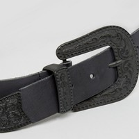 ASOS Large Buckle Leather Western Waist And Hip Belt With Black Metalwork at asos.com