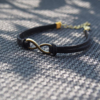 infinity bracelet black with antique brass metal with 4cm extended chain