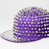 All over spiked snap back hat