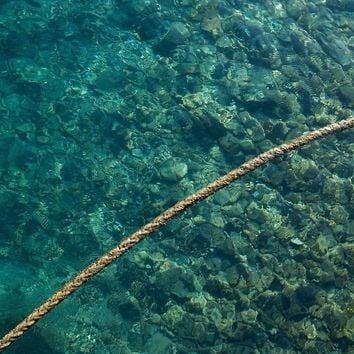 'Rope over clear water' by TheOtherErre