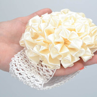 Handmade decorative elastic headband of milky color with flower for baby girl