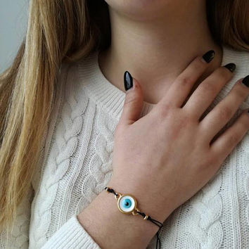 Blue eye bracelet, round blue eye of brass and enamel on black cord, blue eye macrame bracelet, eye friendship bracelet, eye boho cuff