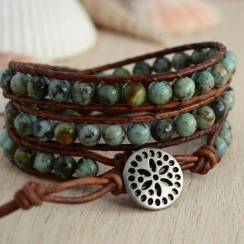 Leather bracelet. African turquoise beads on light brown leather. Wrap bracelet.