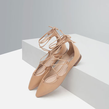 Tie-up leather ballerinas