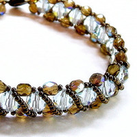 Ice blue bracelet woven with bronze crystals by toofancyjewelry