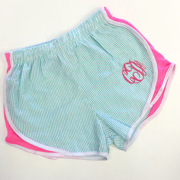 Monogram Women's AQUA Seersucker Shorts with Hot Pink Sides Running Athletic Font shown MASTER CIRCLE in Bright Pink