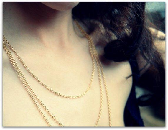 The other woman. A edgy gold multi chained necklace.