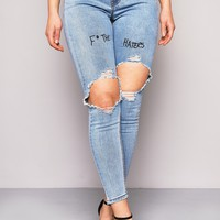 BLUE RIPPED KNEE F* THE HATERS EMBROIDERED SLOGAN SKINNY JEANS