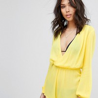 PrettyLittleThing Cheesecloth Wrap Playsuit at asos.com