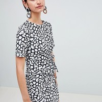 ASOS DESIGN mini dress with wrap skirt in animal print at asos.com