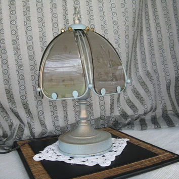 Small Table Lamp, metal with etched  glass  shade.  Color is a soft  blue with  gold tone. Vintage and charming.