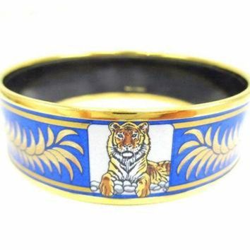 CREY2N Vintage Hermes cloisonne enamel golden thick bangle, bracelet with tiger and crown de Tagre-