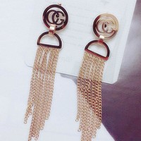 GUCCI fashion temperament letter round ear nail hanging tassel chain oval earrings female titanium steel tiechao female earring gifts