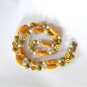 Beaded flower necklace / cream / gold / jade / acrylic / goldtone / vintage / gift / oblong bead / lobster clasp / long length necklace