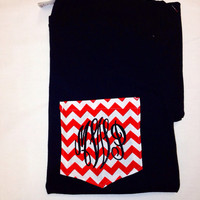 Black ladies tee shirt with red chevron frocket pocket and black monogram