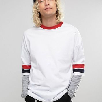 ASOS Oversized Longline Long Sleeve T-Shirt With Retro Color Blocking And Layered Sleeve at asos.com