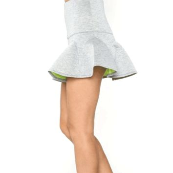 Finish off a stylish outfit with this Delicate Dream Scuba Skater Skirt! This structured skater skirt features heather grey knit contrast with lime green on reverse side, smooth and stretchy scuba diving material, structured seams, flared pleated bottom, s