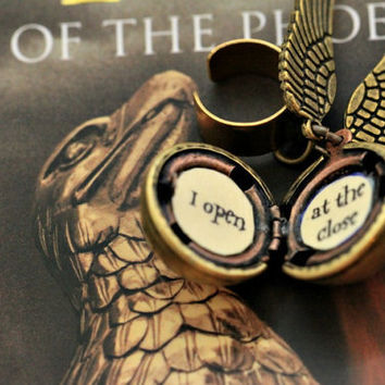Harry Potter Golden Snitch ear cuff Steampunk by PageFromMyBook