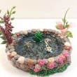 Miniature koi fish pond. Fairy garden accessories, terrarium décor. With starfish, pink plants and flowers.