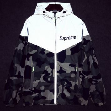 The new Sup Marie skateboards 3M reflective trench coat tide male and female couple models camouflage Jackets jacket class clothes