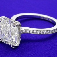 Radiant Cut Diamond Ring: 3.10 carat with 1.12 ratio in 0.35 tcw pave mounting