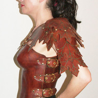 Womans leather armor breastplates with pauldrens in a brown leaf design for LARP, Fantasy, SCA