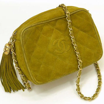 Vintage CHANEL rare color in pistachio green, quilted suede camera bag style shoulder purse with gold tone chain strap and fringe.  Fall