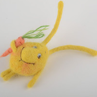 Small handmade brooch felted on natural wool in the shape of cute yellow rabbit