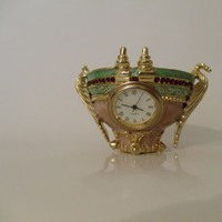 Ormolu Quartz Clock and Vase, Coral and Celadon glazed with ruby glas