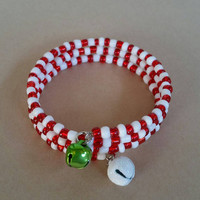 Christmas red and white glass bead memory wire bracelet with 2 jingle bells