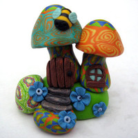 Magical millefiori mushroom house, miniature scene with little fairy door and contented bee
