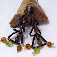 Animal print geometric triangle earrings with green and amber Swarovski crystals