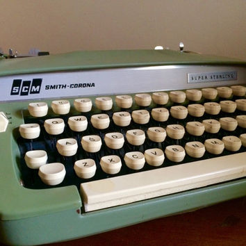 Green and white manual working smith corona super sterling typewriter with case