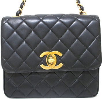 Vintage CHANEL black lamb leather jumbo square shoulder bag with a big gold CC hock and chain strap. 2.55 classic chain tote