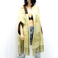Vintage 60s / 70s fringed leather poncho / size S / M / tooled leather cape / western boho cowboy hippie