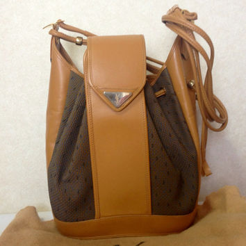 0cbcc7426f Vintage Yves Saint Laurent hobo bucket shoulder shoulder bag with brown  leather
