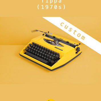 REFURBISHED TO ORDER /// 1970's Triumph Tippa Typewriter. Fully working. Yellow. German portable. With original black case.