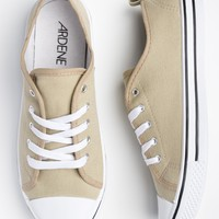 Sandy beige canvas laced sneakers with white rubber tip