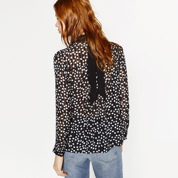POLKA DOT PRINT BLOUSE WITH A HIGH NECK DETAILS