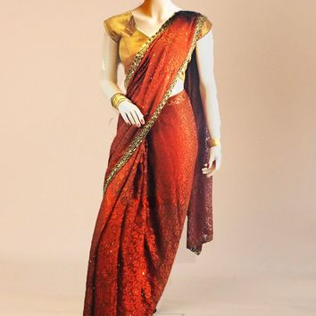 The dusky saffron silk saree with golden trim