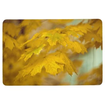 Yellow autumn maple leaves. floor mat